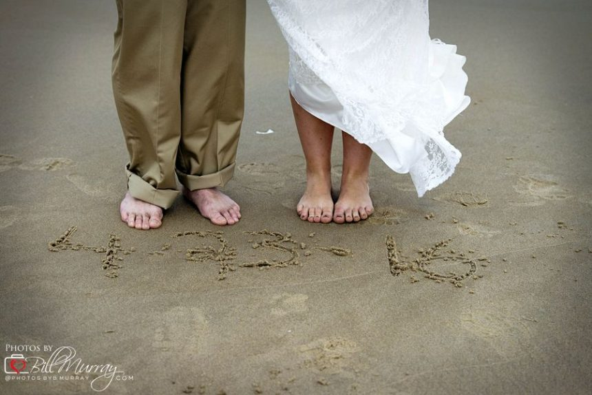 sandbridge wedding couple feet in the sand