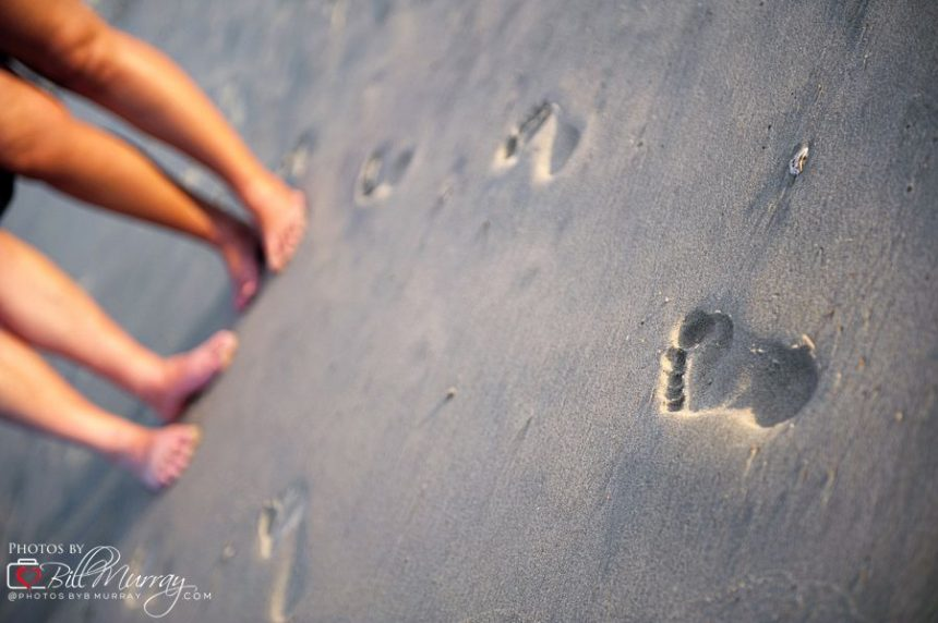 footprints in the sand engagement photo