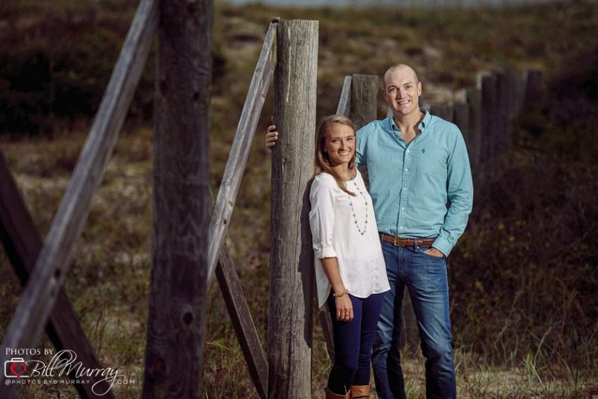 beach engagment photo in the dunes